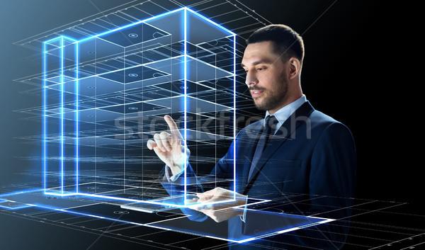 üzletember táblagép épület hologram üzletemberek jövő Stock fotó © dolgachov