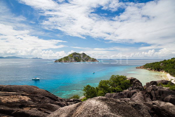 island and boats in indian ocean on seychelles Stock photo © dolgachov