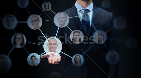 businessman with network contacts over black Stock photo © dolgachov