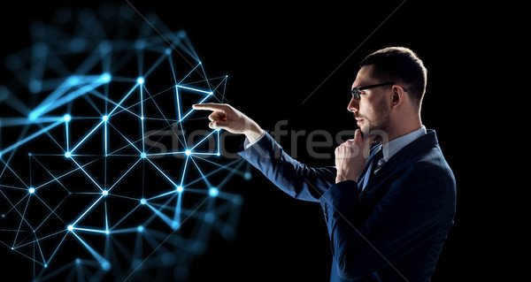businessman with low poly projection Stock photo © dolgachov