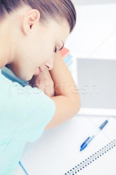 Fáradt diák alszik stock könyvek üzlet Stock fotó © dolgachov