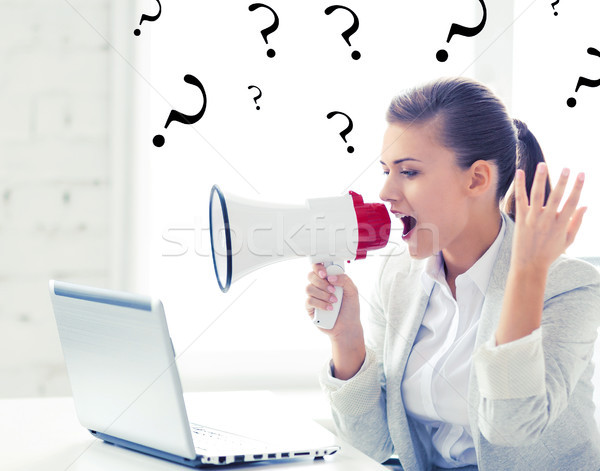 strict businesswoman shouting in megaphone Stock photo © dolgachov