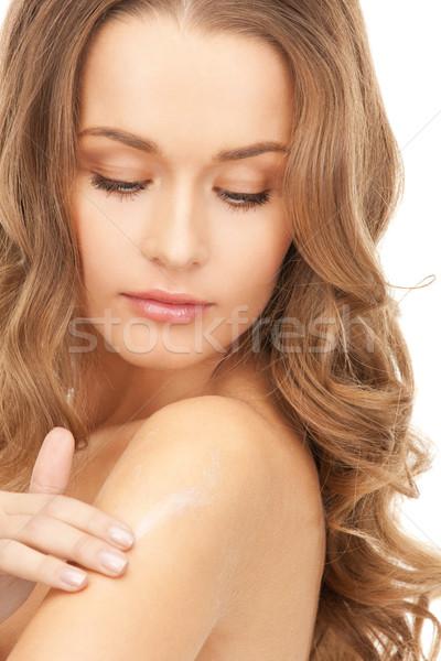 beautiful woman with moisturizing creme Stock photo © dolgachov