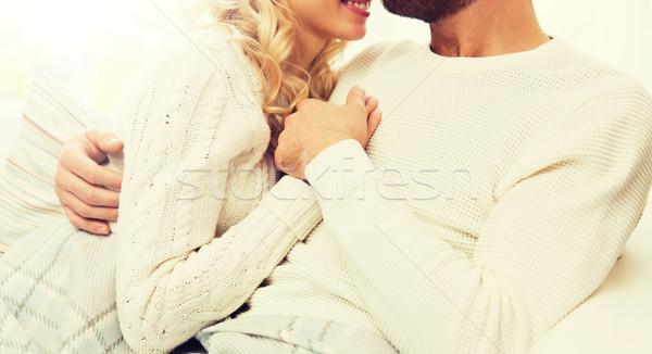 close up of happy couple cuddling at home Stock photo © dolgachov