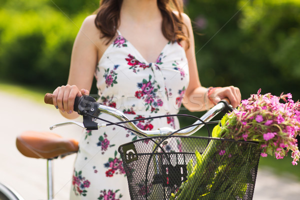 close up of woman with fixie bicycle in park Stock photo © dolgachov