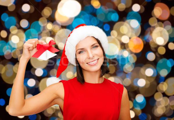 Szczęśliwy kobieta Święty mikołaj hat christmas wakacje Zdjęcia stock © dolgachov