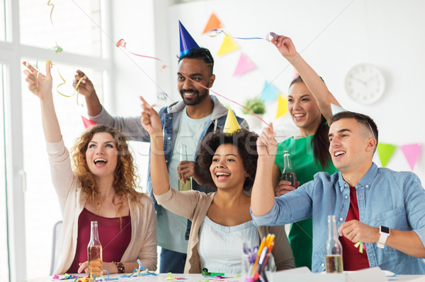 happy team with confetti at office birthday party Stock photo © dolgachov