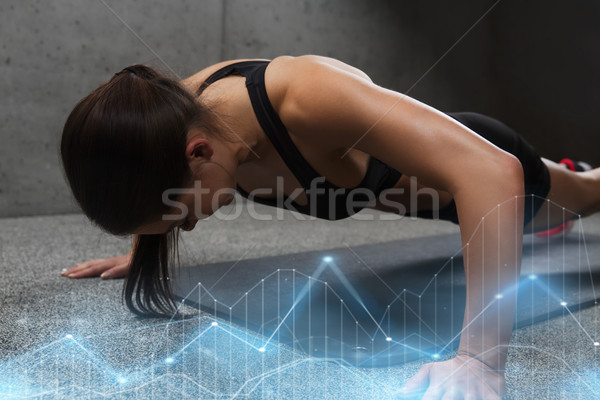 woman doing push-ups in gym Stock photo © dolgachov