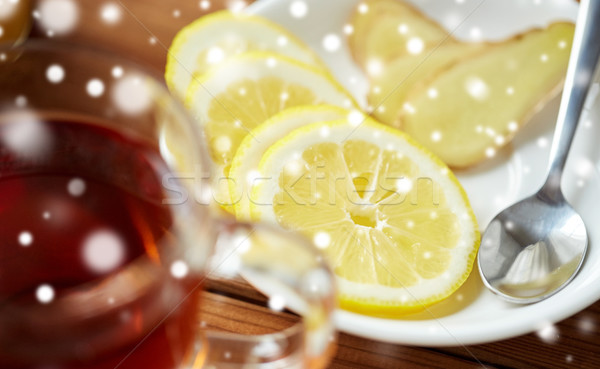 tea cup with lemon and ginger on plate Stock photo © dolgachov