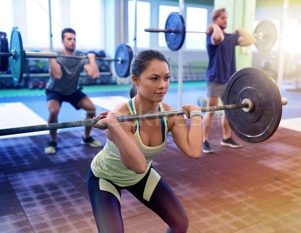 Grupy ludzi szkolenia siłowni fitness sportu Zdjęcia stock © dolgachov