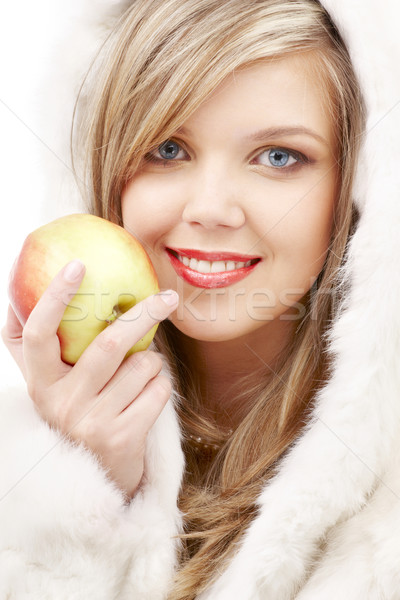 lovely blond in fur with apple Stock photo © dolgachov