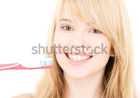 happy teenage girl with wooden model dummy Stock photo © dolgachov