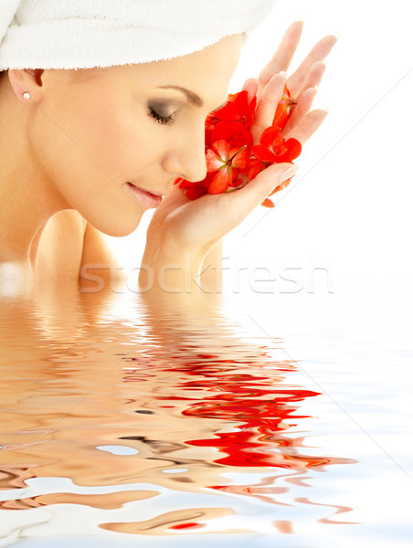 lady with red petals in water Stock photo © dolgachov