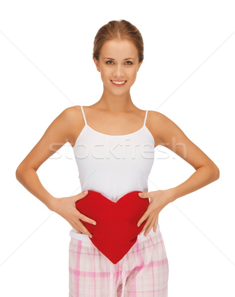 happy and smiling woman with heart-shaped pillow Stock photo © dolgachov
