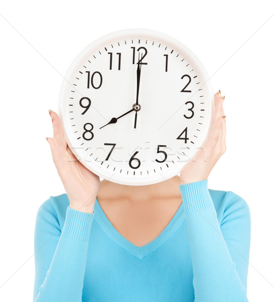businesswoman with clock over her face Stock photo © dolgachov