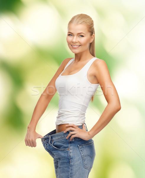 женщину большой брюки фотография Сток-фото © dolgachov