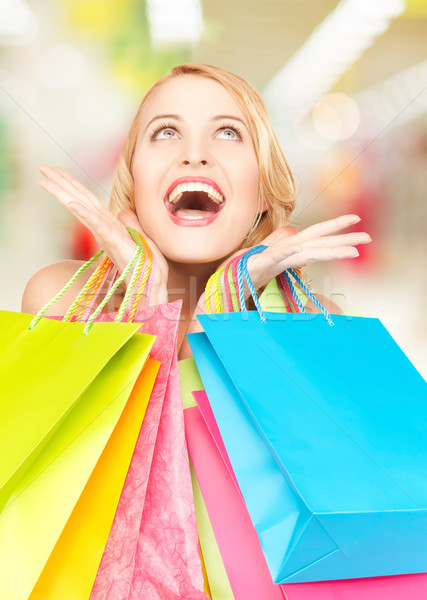 Stock photo: happy woman with shopping bags