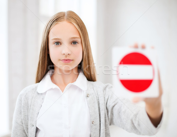 girl showing no entry sign Stock photo © dolgachov