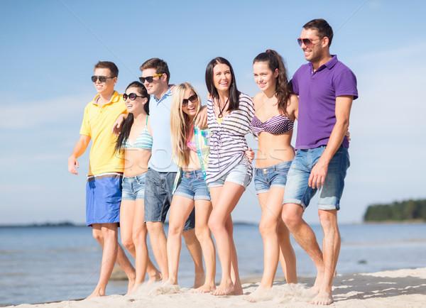 Groep vrienden strand zomer vakantie Stockfoto © dolgachov