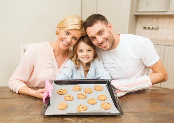 счастливая семья Cookies домой продовольствие семьи Сток-фото © dolgachov