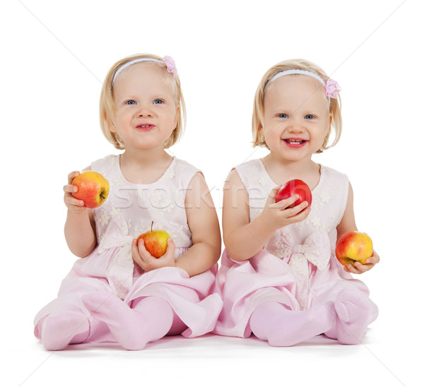 two identical twin girls playing with apples Stock photo © dolgachov