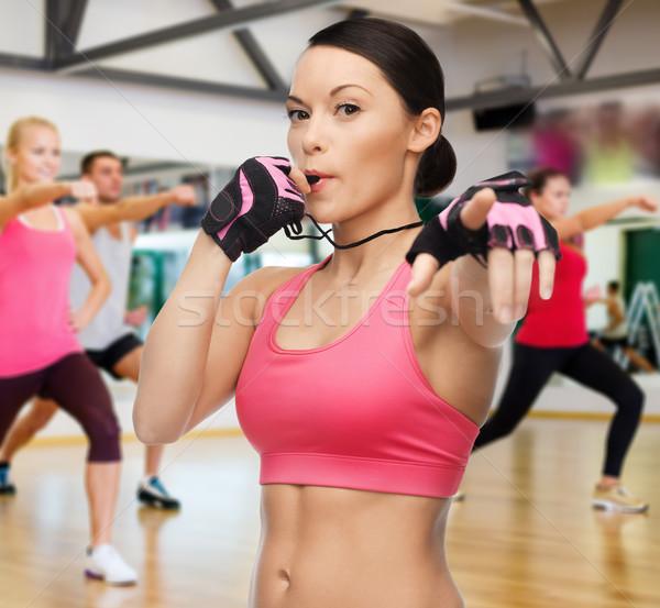 Kadın ıslık spor salonu uygunluk spor eğitim Stok fotoğraf © dolgachov