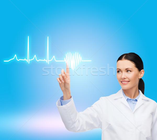 笑みを浮かべて 女性 医師 ポインティング 心電図 医療 ストックフォト © dolgachov