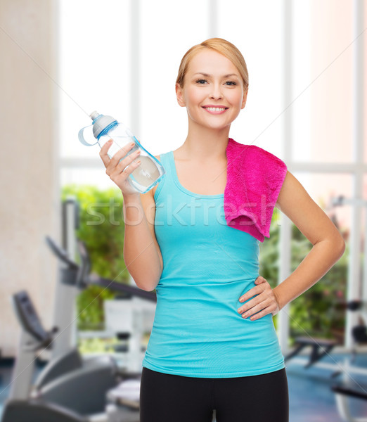 sporty woman with towel and watel bottle Stock photo © dolgachov