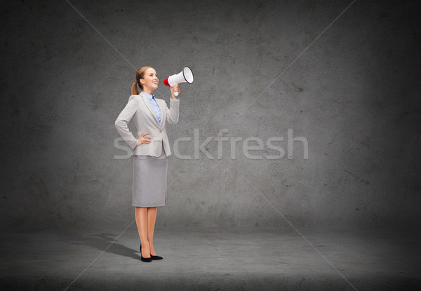 Stockfoto: Glimlachend · zakenvrouw · megafoon · business · communicatie · kantoor