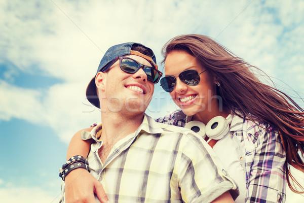 smiling teenagers in sunglasses having fun outside Stock photo © dolgachov