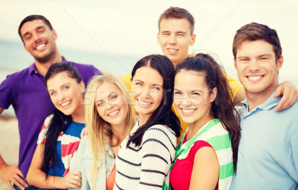 group of friends having fun on the beach Stock photo © dolgachov