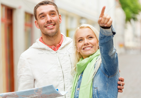 happy couple with map exploring city Stock photo © dolgachov