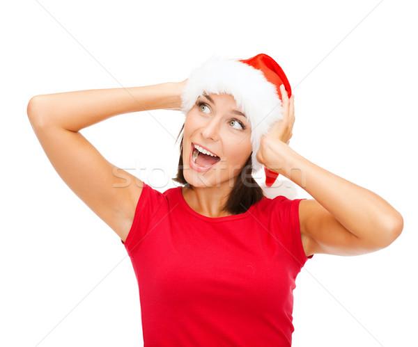 Meglepődött nő mikulás segítő kalap karácsony Stock fotó © dolgachov