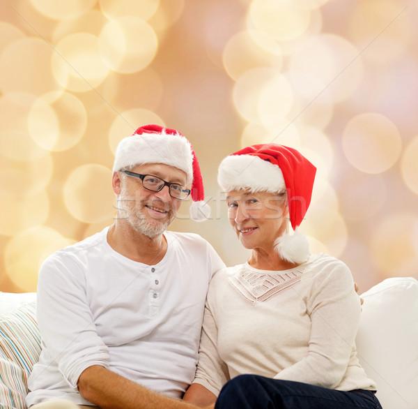 Boldog idős pár mikulás segítő sapkák család Stock fotó © dolgachov