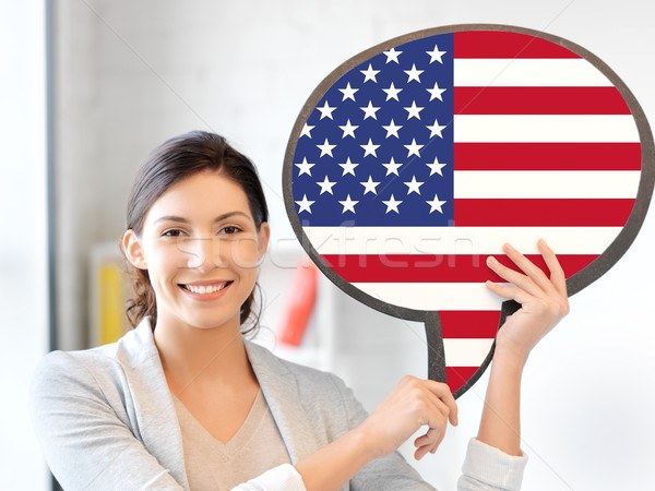 smiling woman with text bubble of american flag Stock photo © dolgachov