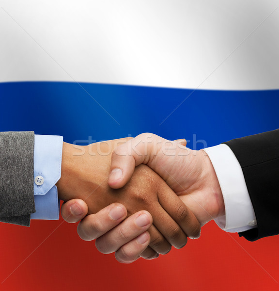 close up of handshake over russian flag Stock photo © dolgachov