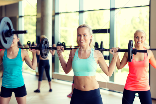 group of women with barbells in gym Stock photo © dolgachov