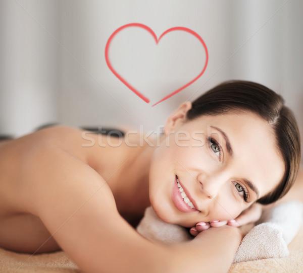 beautiful woman in spa salon with hot stones Stock photo © dolgachov