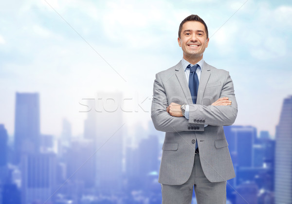 Stock photo: happy smiling businessman in suit