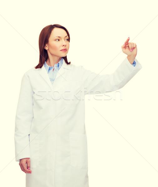 Orvos mutat valami kisajtolás gomb egészségügy Stock fotó © dolgachov