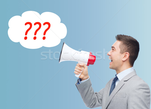 happy businessman in suit speaking to megaphone Stock photo © dolgachov