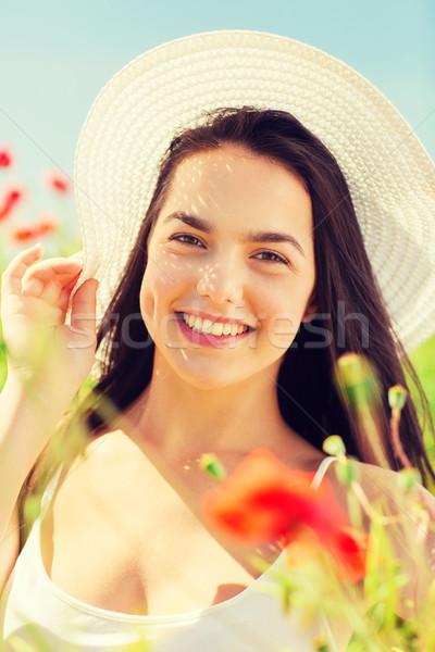 笑みを浮かべて 若い女性 麦わら帽子 ケシ フィールド 幸福 ストックフォト © dolgachov
