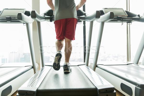 Közelkép férfi lábak fut futópad tornaterem Stock fotó © dolgachov