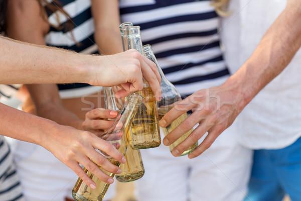 Eller şişeler içecekler tatil kutlama Stok fotoğraf © dolgachov