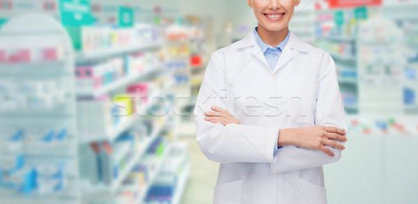 Młoda kobieta farmaceuta apteka apteki muzyka ludzi Zdjęcia stock © dolgachov