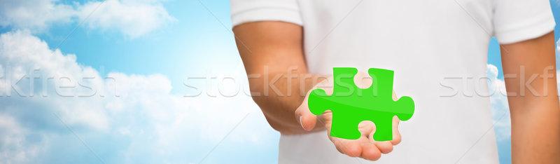 man holding green puzzle over sky background Stock photo © dolgachov