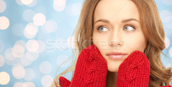 happy young woman in red mittens over blue lights Stock photo © dolgachov