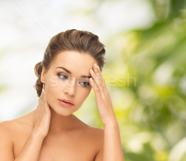 woman holding hands on her neck and forehead Stock photo © dolgachov