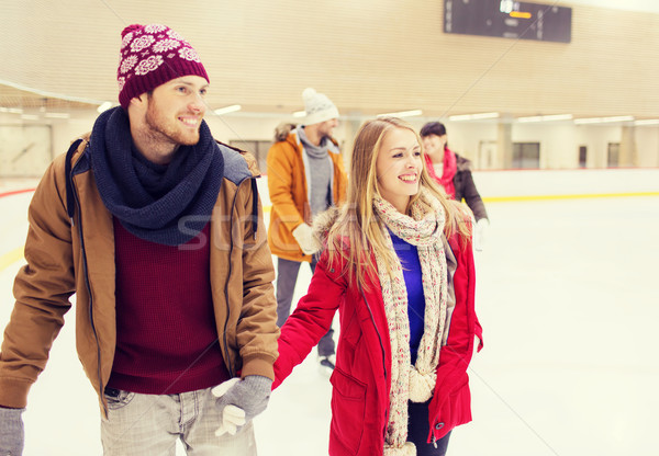 Stock photo: happy friends on skating rink