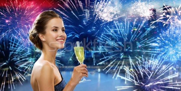 happy woman drinking champagne wine over firework Stock photo © dolgachov